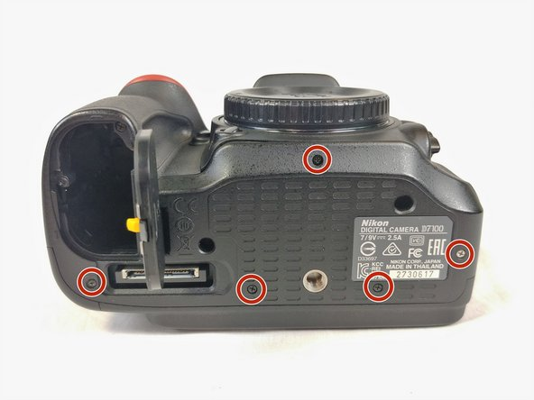 Remove the five screws on the bottom of the camera with a JIS #000 head screwdriver.