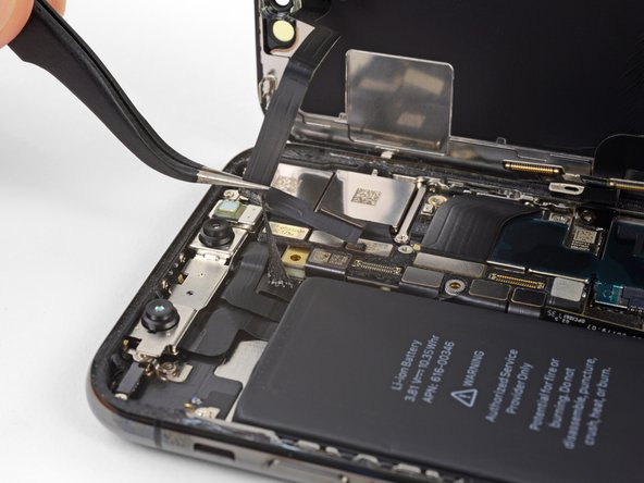 Carefully lift the cable until the adhesive separates.