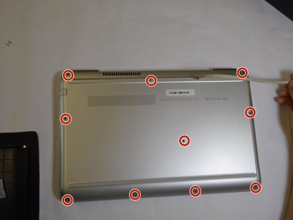 Remove the ten screws from the back case with a Phillips #0 screwdriver.