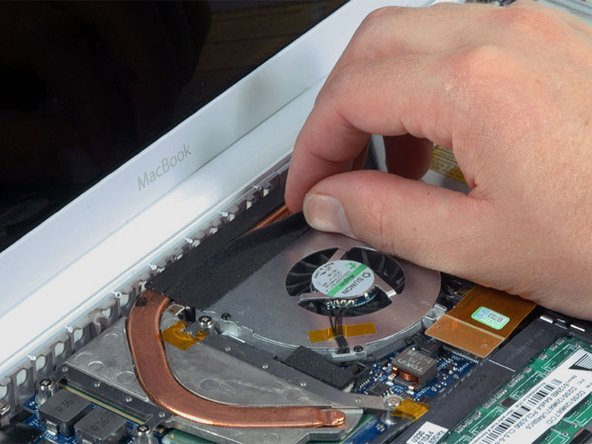 Carefully peel up the black felt tape between the heat sink and fan.