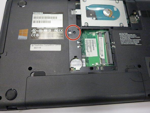 Using a Phillips #0 screwdriver, remove the single 3mm screw.