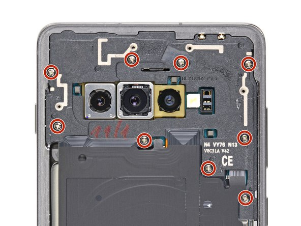Remove the nine 4 mm Phillips screws securing the top midframe to the phone.