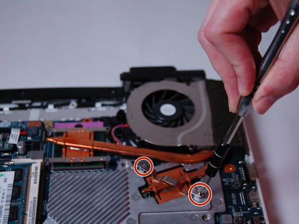Locate the fan and use a Phillips #0 screwdriver,  remove the two screws (Length: 7.7 mm) that hold it in place.