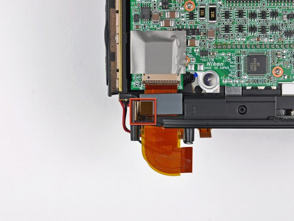 Peel back the piece of tape connecting the iron core around the CCD board ribbon cable to the inner case.