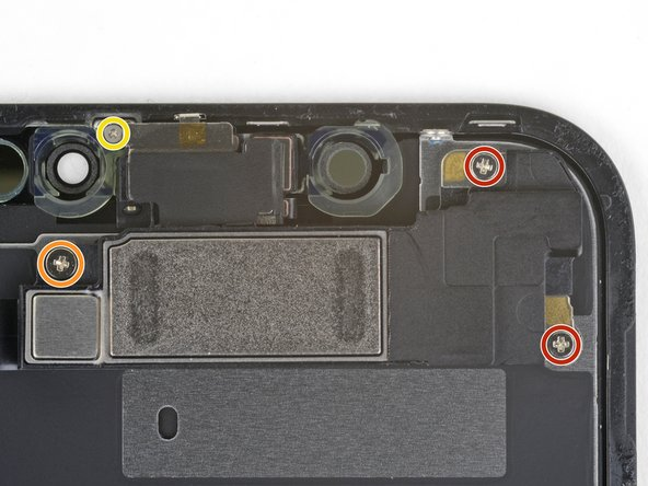 Remove the four screws securing the speaker/sensor assembly to the back of the display:
