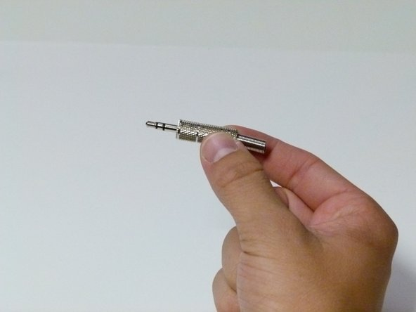 Unscrew the casing from your replacement plug.