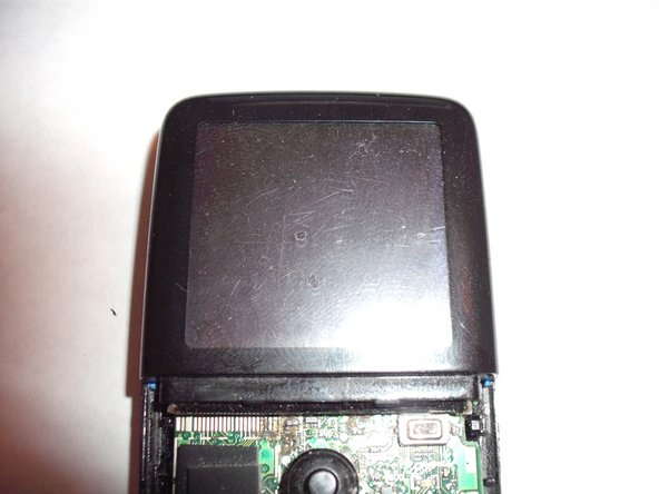 While doing the following steps note that this piece is glued on to the LCD. Do not apply too much force or shove your tool too far in