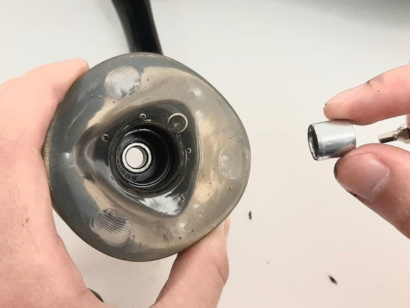 Remove the spacer that sits between the bearings on the inside of the wheel.