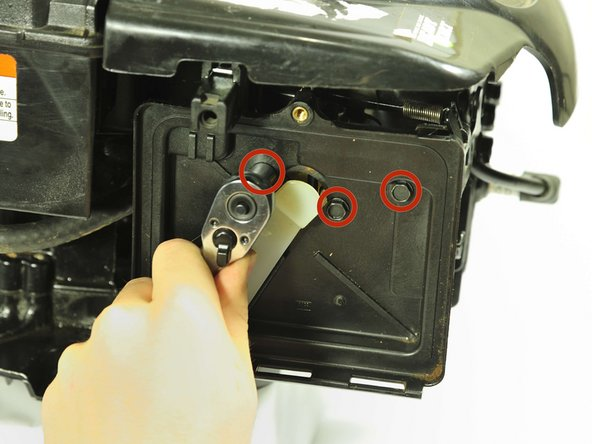 """Use a socket wrench with a 5/16"""" hex bit to remove three 20mm bolts behind the air filter."""