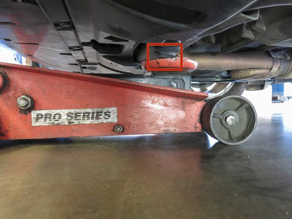 Identify the jack point, located directly underneath your car, in the center portion between the front two wheels.