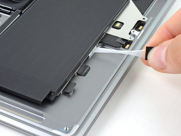 Repeat and remove the three adhesive strips from the right side of the battery.
