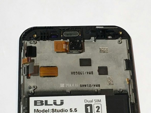 After the motherboard has been removed you will see the back camera, which is glued to the phone assembly.