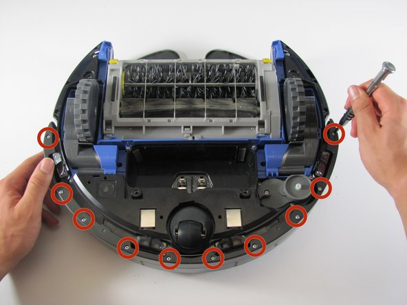 Remove the ten 11mm screws that hold the front bumper to the plastic bumper protector with your Phillips #1 screwdriver.