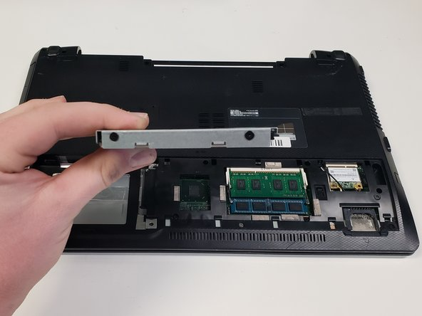 Remove the hard drive from the slot.