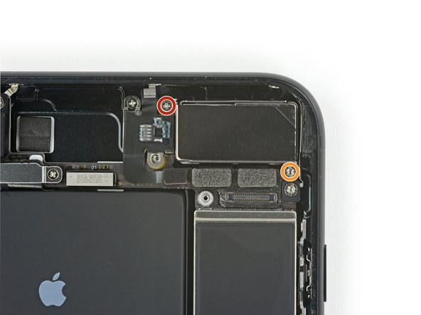 Remove the two screws securing the rear-facing camera bracket: