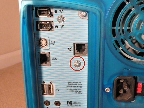 Remove the Phillips #1 screw circled in the picture. Set it aside for re-assembly.