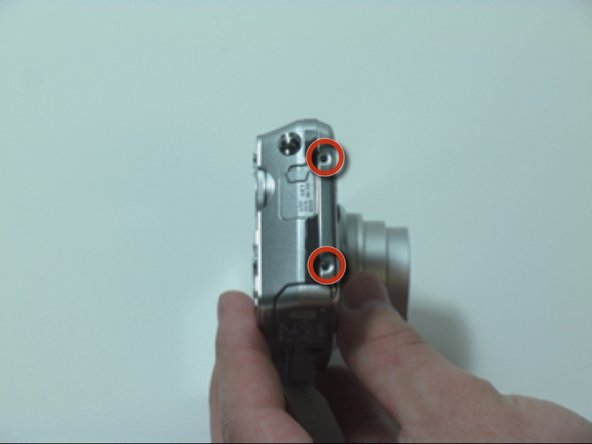 Remove the 2 screws from the left side of the camera