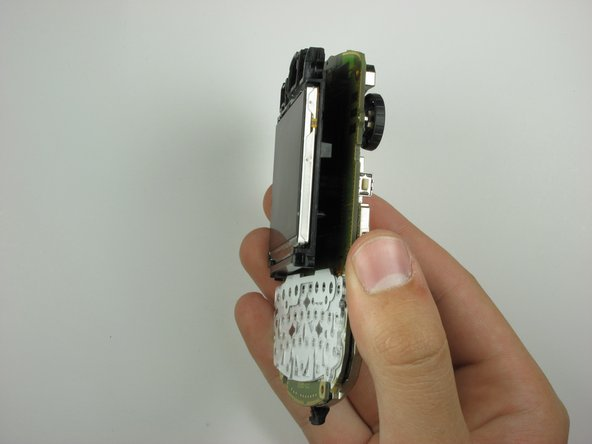 With the clip unhooked, gently separate the display from the phone internals by pulling.