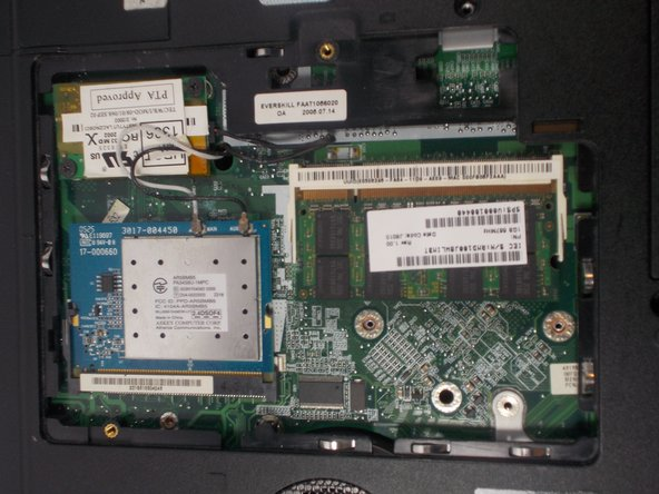 The computer should be open with many of the internal components shown. You can now access the RAM, and wireless card.