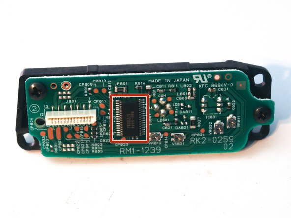 The board mounted on the side of the laser assembly contains the infrared laser diode and a photodiode to sense the beam direction. It has a chip marked as RH4-5444, for which no datasheet could be found.
