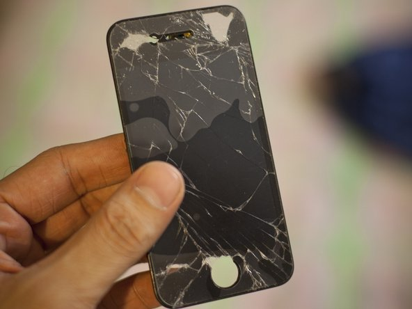 I got this damaged iPhone 4 screen from a local repair guy. He gave it to me for free as it is of no use to him.