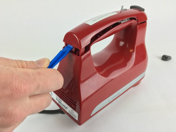 Pop up the panel with a plastic opening tool.