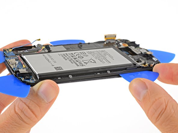 Use an opening pick to gently pry the battery side of the frame away from the display.