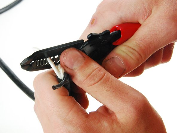 Using wire strippers, strip a half an inch to three quarters of an inch of insulation off of each wire.