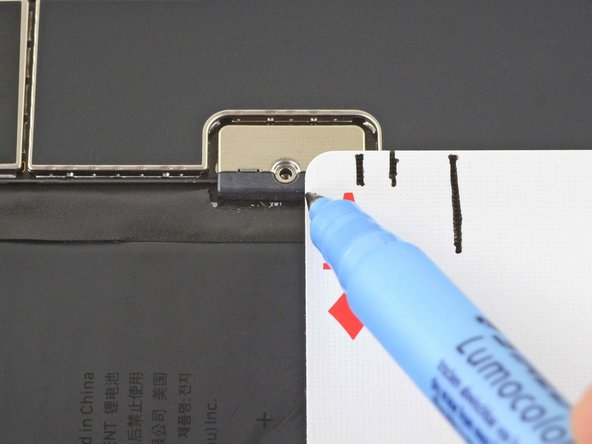 Line up the top edge of the card with the top edge of the screw hole.