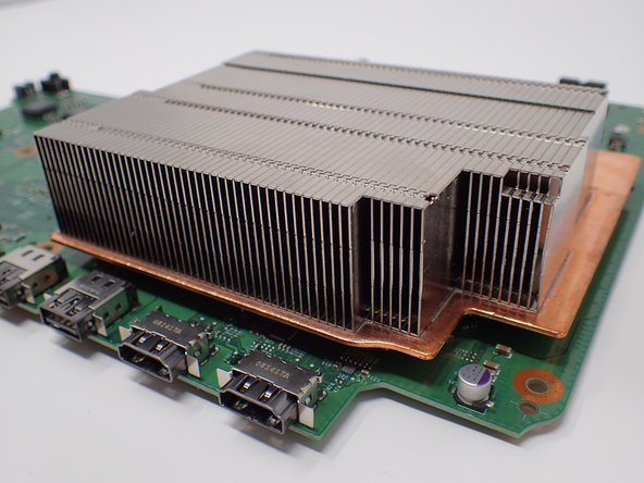 Lift the heat sink to detach it from the motherboard.