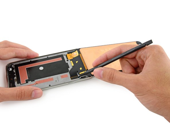 Use the sharp tip of a spudger to lift the front panel assembly cable connector straight up off its socket on the motherboard.