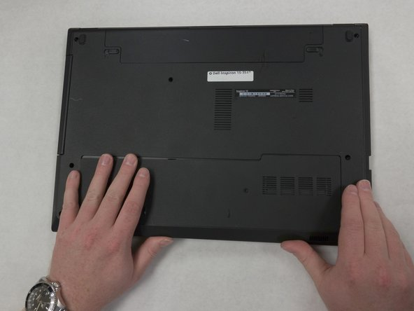 Slide the panel off by placing your hands on top and, while using a little force, sliding your hands down.