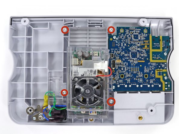 Remove the four T10 Torx screws from the power supply cover.