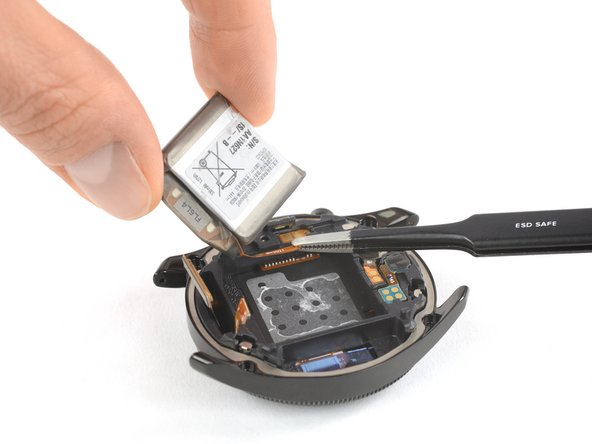 Lift the battery up a little in order to access its glued down connector cable.