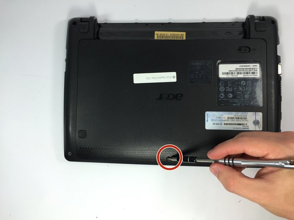 Remove the screw on the bottom of the netbook.