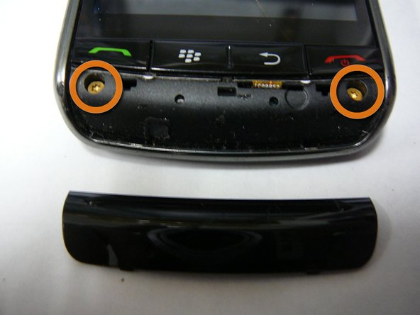 Remove the two screws(T6) as shown.