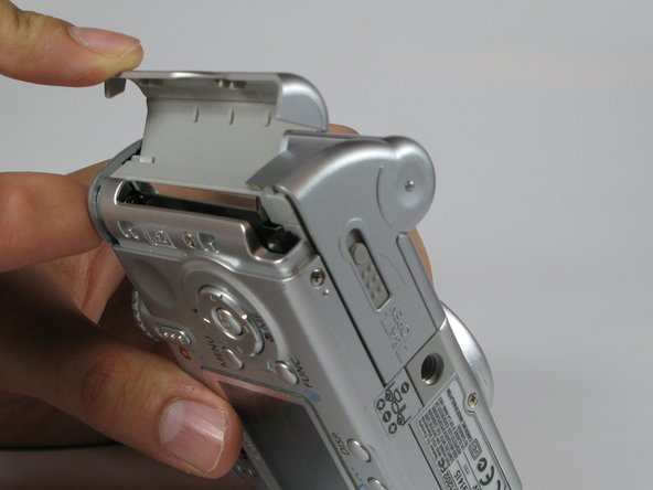Open the memory card slot by sliding it laterally until you hear a click.