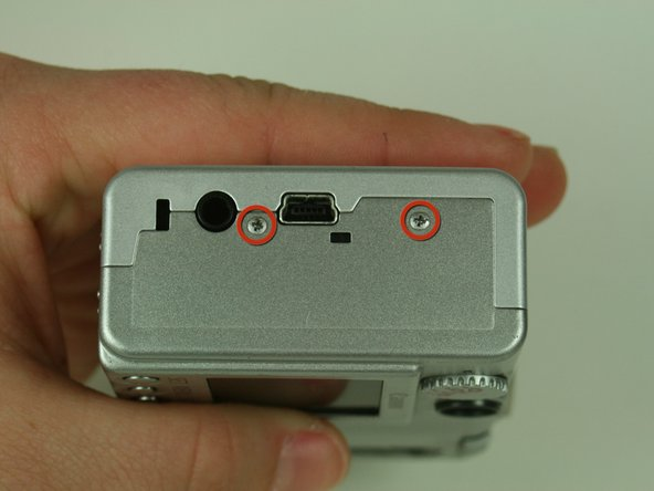 On the side of the camera, remove the two 4.75 mm screws that sit near the USB digital terminal.