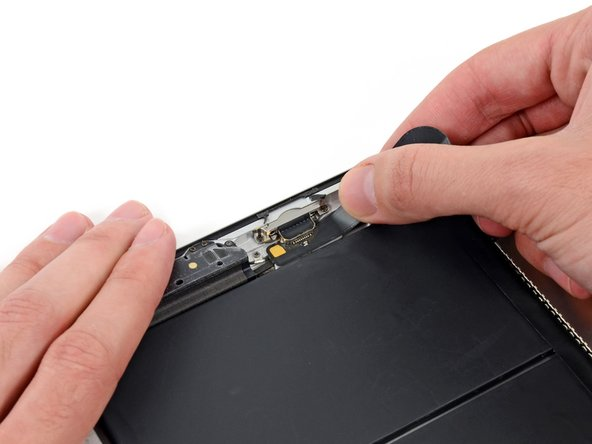 Pull the Lightning connector straight out of its recess in the rear case.