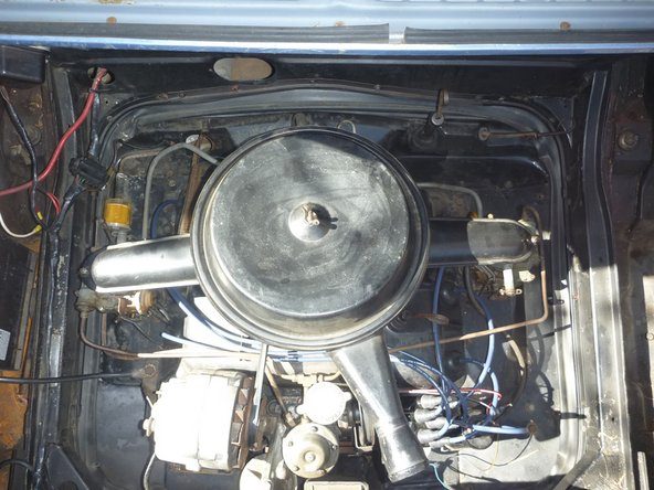 Finally, raise or lower the idle speed screws until the idle speed is about 550 RPM