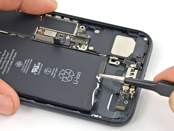 Use a pair of tweezers with blunt tips to peel back the other adhesive strip on the lower edge of the battery.