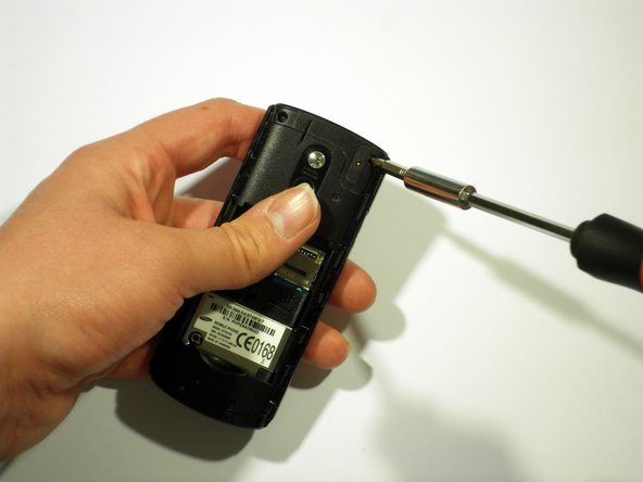 Next, using a Philips screwdriver, remove the five screws from the back of the device.