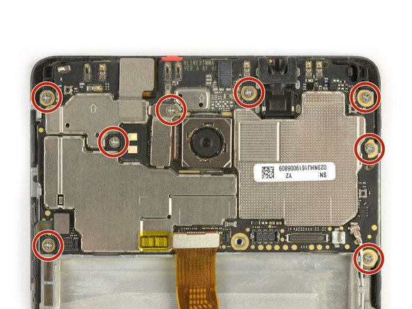 Remove the eight Phillips #00 screws securing the motherboard to the phone.