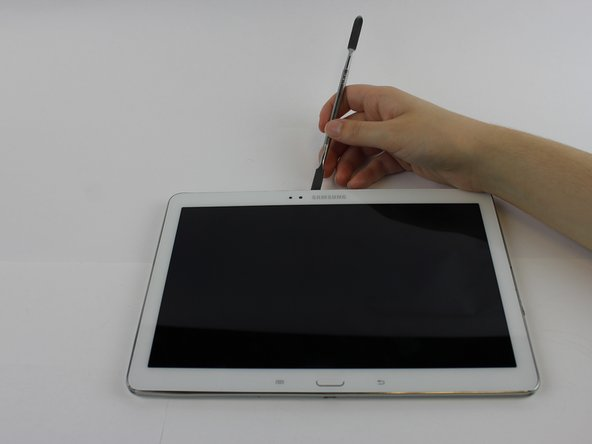 Using the nylon spudger or plastic opening tool along the edges of the screen, separate the back case off of the device.