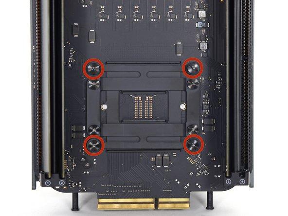 Remove four 12.8 mm T10 Torx screws from the CPU heat sink bracket.