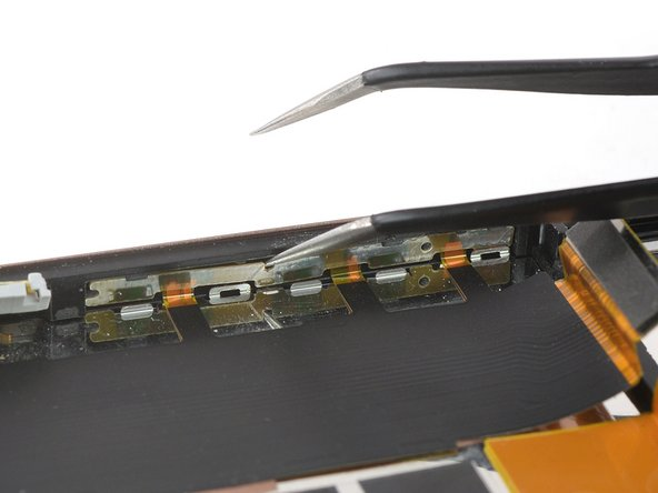 Use a pair of tweezers and carefully pry the top left part of the main flex cable away from the midframe.
