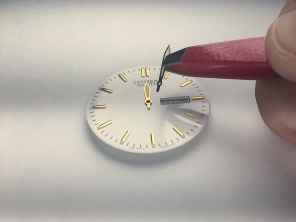Use the tweezers to replace the hands of the watch.