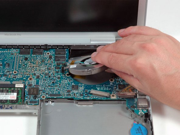Lift the right fan up and carefully peel up the tape securing the fan to the heat sink as you go.