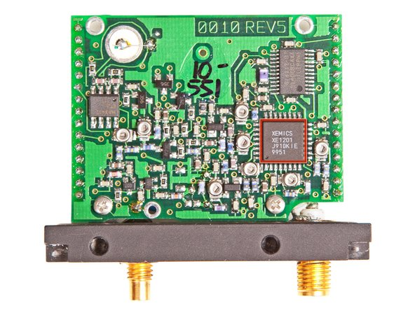 The larger of the two boards contains the connections for both antennas and is responsible for the RF side of the tracking device. Its notable chips include: