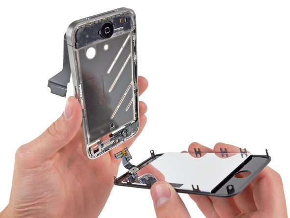 De-route the digitizer and LCD cables through the steel inner frame, and remove the display from the iPhone.